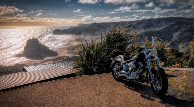 Piha - Lion Rock with a Motorbike at the lookout