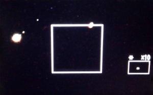 Jupiter at left, Saturn at right - with 3 of Jupiter's Moon
